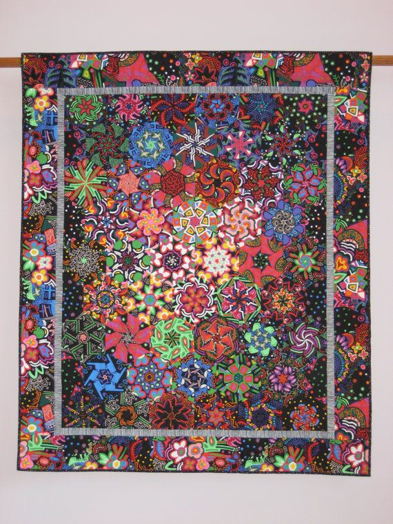 I love all the contrasting colors in this quilt... it reminds me of looking through a kaleidoscope as a child.