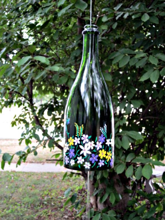 Beautiful deep green, thick recycled glass bottle. Turned into a wonderful sounding bell style wind chime. Hand painted purple and yellow flowers