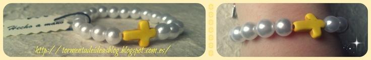 Pulsera elástica con perlas de imitación y abalorio en forma de cruz amarilla  Precio: 2,50 €/unidad + 0,50 € de gastos de envío