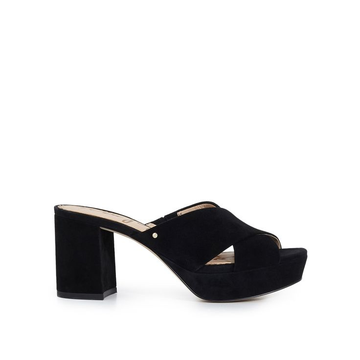 The Jayne Platform Mule Sandal is retro and totally chic. With its cross-strap hold and mod, block platform, this sandal looks great with a bohemian dress or boyfriend fit jeans.  Platform Mule Cross Strap SandalClosure: Slip-OnToe: OpenHeel Height: 3 inchesPlatform height: 1 inchMaterial: SuedeInsole: Synthetic