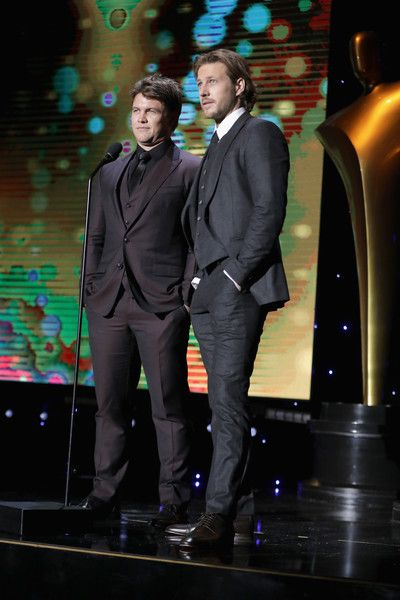Luke Bracey Photos - Actors Luke Hemsworth (L) and Luke Bracey speak onstage during The 6th AACTA International Awards on January 6, 2017 in Los Angeles, California. - The 6th AACTA International Awards - Ceremony