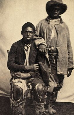 A pair of former slaves, photographed after their escape.  [Across the South, in the years leading up to the war, the thought of slave uprisings struck fear in the hearts of slave-owners.] (Corbis)