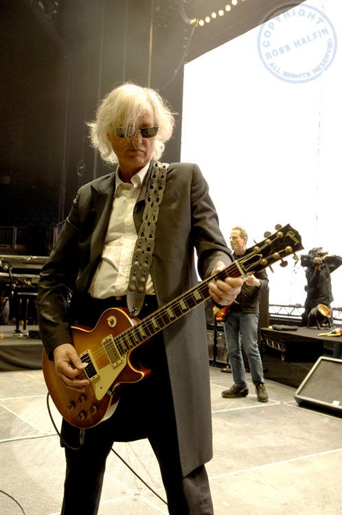 - Jimmy Page of Led Zeppelin. Still rocking his signature Les Paul.