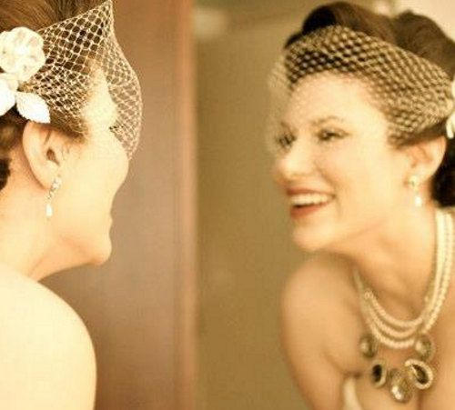 Real bride Stephanie answers a question how to wear our birdcage veil in a stylish way.