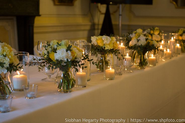 Imperial table with white and yellow flowers for Pritika and Davide's wedding in Rome. www.weddingsinrome.com
