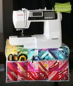 Brighten your sewing room with this fun, colorful, scrap-busting machine cover, which can also be used as an organizing sewing mat.