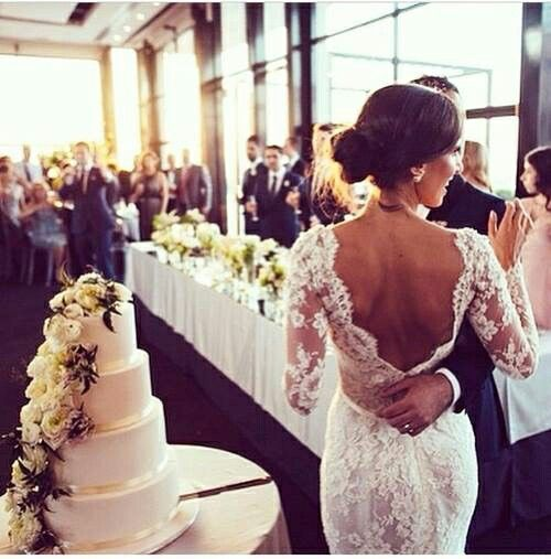 Gorgeous lace wedding dress, beautiful wedding cake
