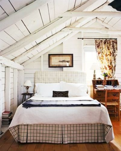 White washed planks, flowery curtains