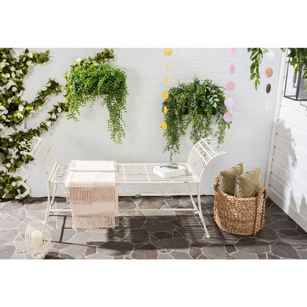 Inspired by a Victorian daybed, this wonderfully detailed antique white outdoor garden bench is pretty enough to grace indoor spaces. Replete with graceful swirls, this sturdy iron bench is finished w