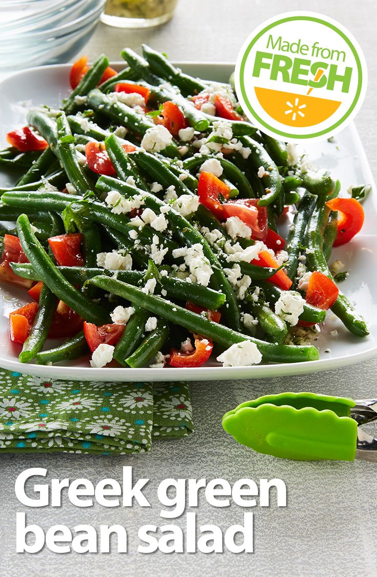 Fresh, crisp green beans, juicy tomatoes, and tangy feta cheese go Greek in this zesty salad that's packed with flavor and color. It's a treat for the mouth and the eyes!