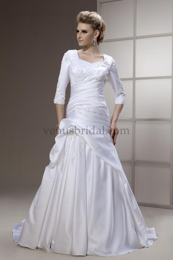This modest dress has 3 4 length sleeves design by venus for Modest wedding dress designers