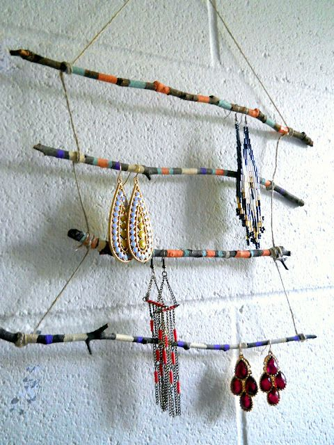 Very hippie, i love it! An earring holder made out of painted twigs. and they are so pretty, I almost forget about the cute earrings, almost.