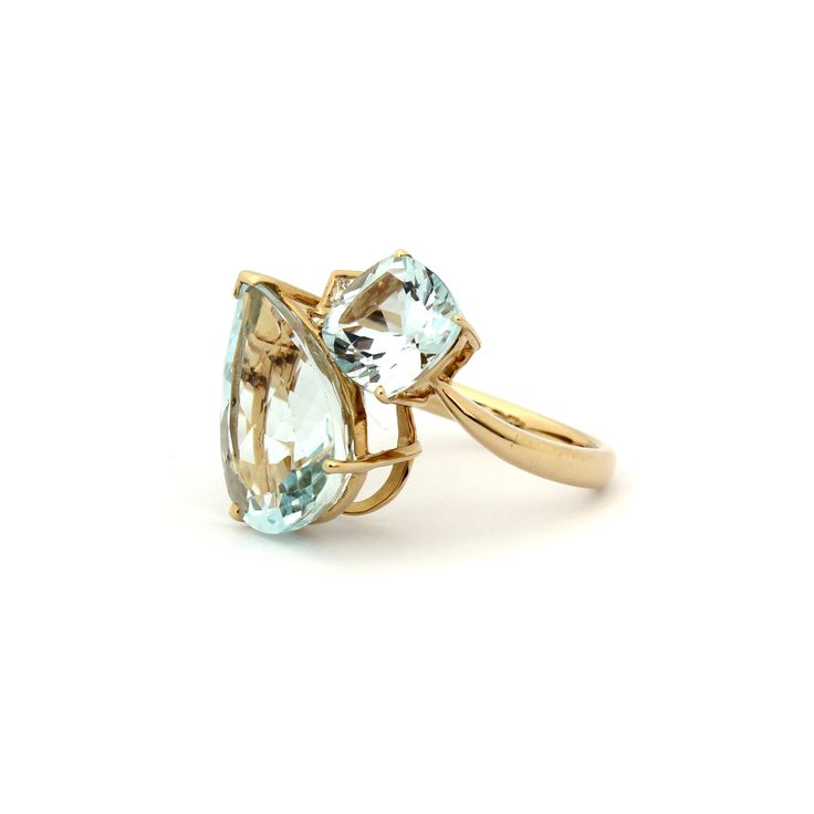 Atmosphere Cluster Ring | This beautiful ring is made using eye clean Aquamarine pear shape and cushion cut gemstones and Diamonds.    Set in 18 karat yellow gold, this beautiful piece is distinguished with a touch of flare. #GiftIdea #FineJewellery #Glamour #Sophistication #Lifestyle