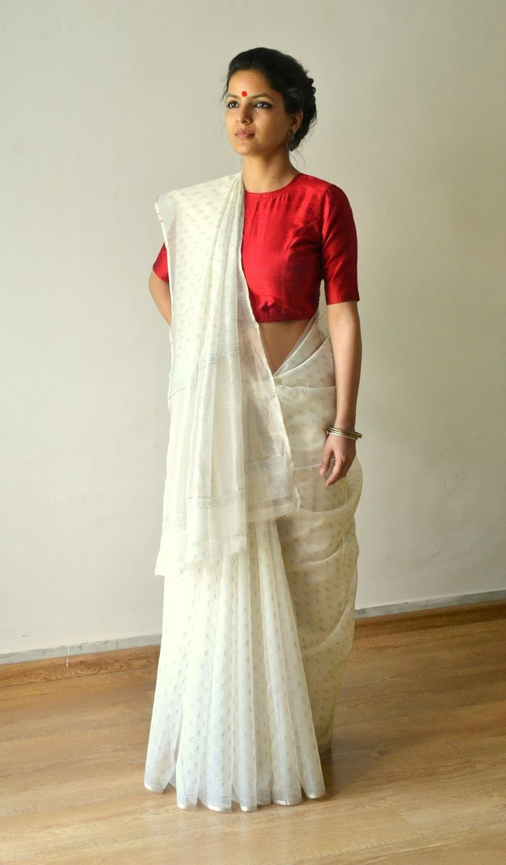 Classic raw silk blouse that perfectly matches most sober colour sarees !