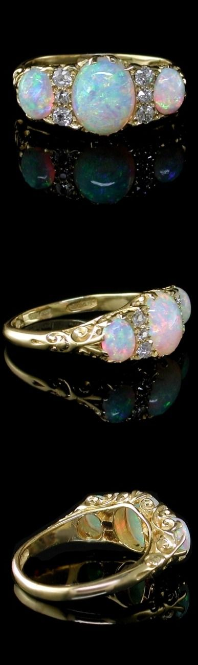 Antique Opal Ring A fine quality Edwardian original opal and diamond ring, The three well coloured opals are of graduated size and mounted along with six antique cut diamonds in a very attractive traditional carved setting. 18ct hallmarked shank for London, 1909.