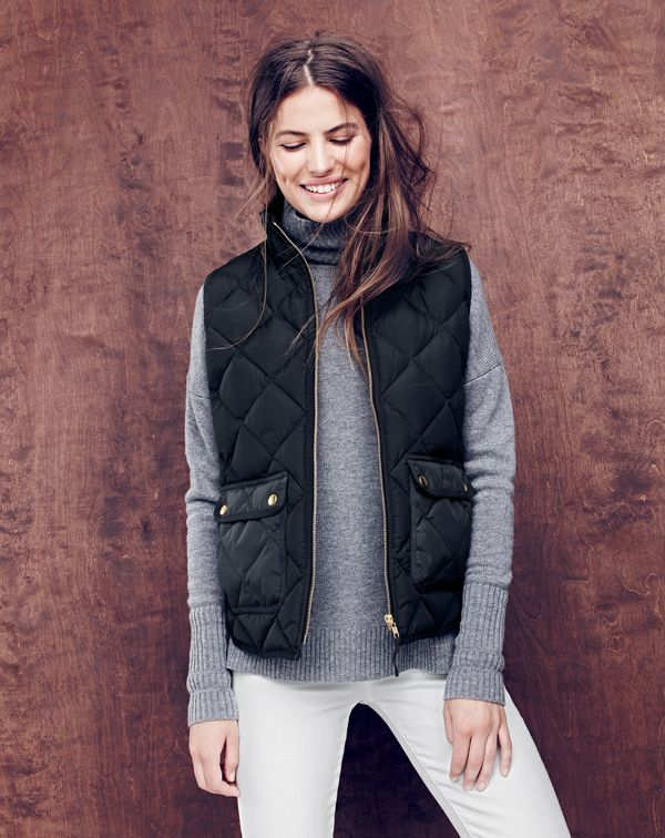 NOV '15 Style Guide: J.Crew women's excursion quilted down vest, turtleneck sweater with rib trim and lookout high-rise Cone Denim® jean in white.
