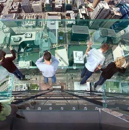 Transparent balcony on 103th floor skyscraper of Sears Tower in Chicago. | See More Pictures