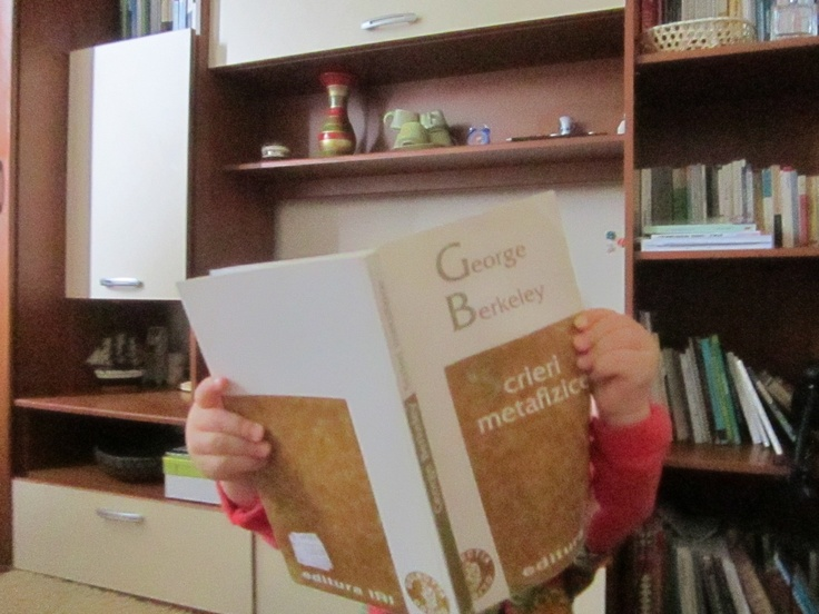 my daugther, 1 year old, is very serious...she reads metaphysics :)