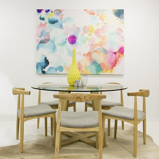 //Set The Scene// This Drift watercolour canvas print brings colour and warmth to this dining space during the cold winter days and nights// this timber base MRD Ravelle Round table $990, Birkin Vase $79.95, Caparina Tealight Holders $9.95 each, Urban Road Drift Canvas Print $599.00, MRD Lotte Dining Chairs $374.00 each// We can help you create this space in your home, call us today on 07 55 239 825.