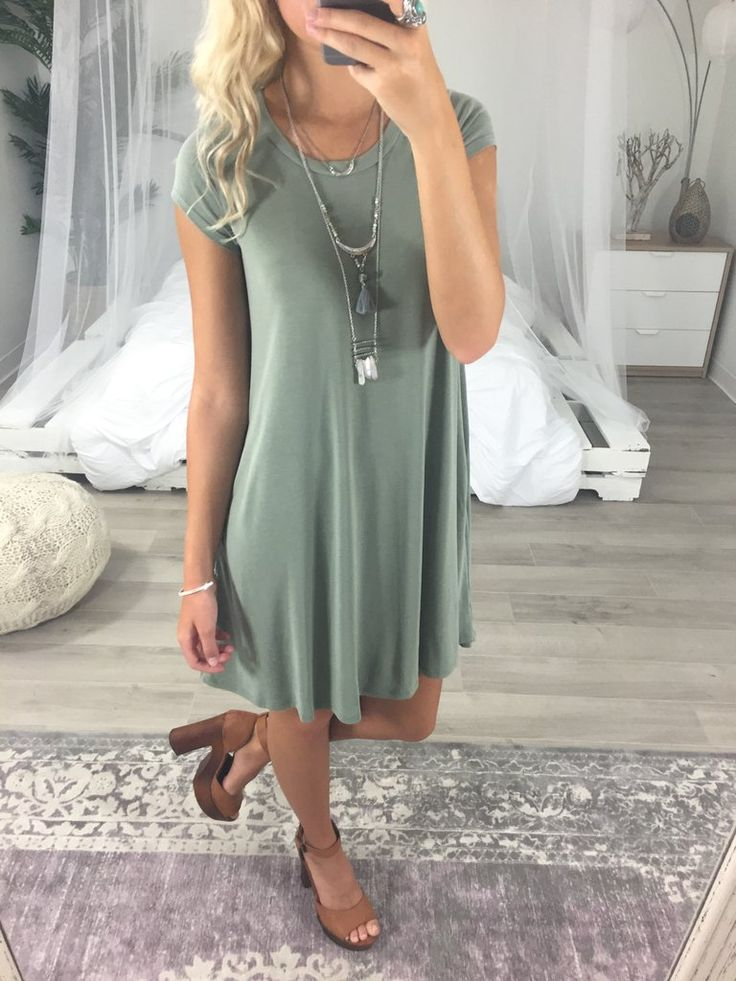 Trendy olive short sleeve dress. Lipari Islands is a solid shift dress featuring cap sleeves and a rounded neckline. Dress has pockets. Material is Rayon and Po