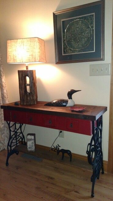 Sewing machine legs and reclaimed barnwood tabletop.
