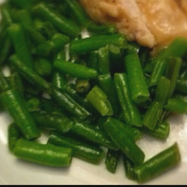 A quick and delicious way to prepare frozen green beans! Pre-heat oven to 350, Toss a bag of frozen green beans in 2-3 Tablespoons of olive oil... Sprinkle with garlic salt (optional) spread green beans on a baking sheet and bake for 15 minutes... Delish!