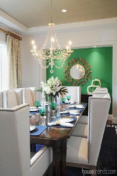 Green accent wall livens up a dining room