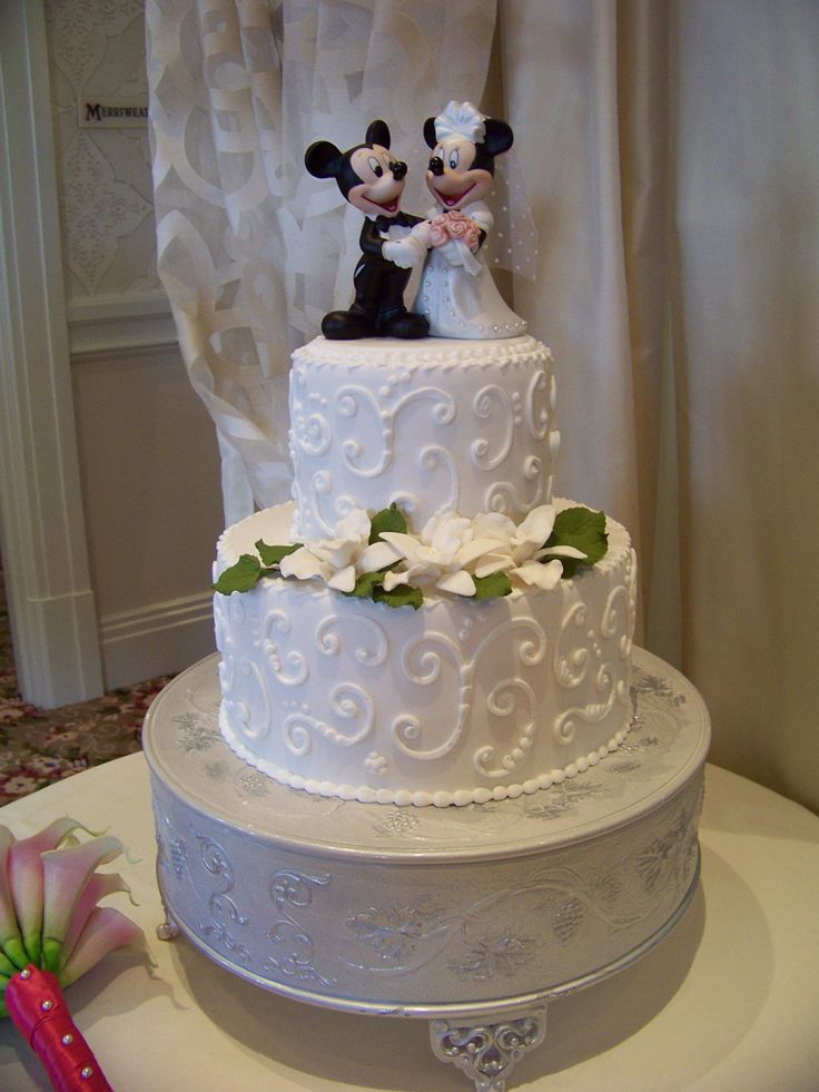 A Mickey and Minnie Wedding Cake would be so fun!