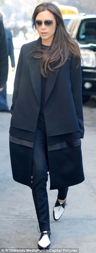 VB //  An edgy look in one of her own coats, a voluminous style that widens at the hem. Ultra-skinny cigarette pants show off the legs