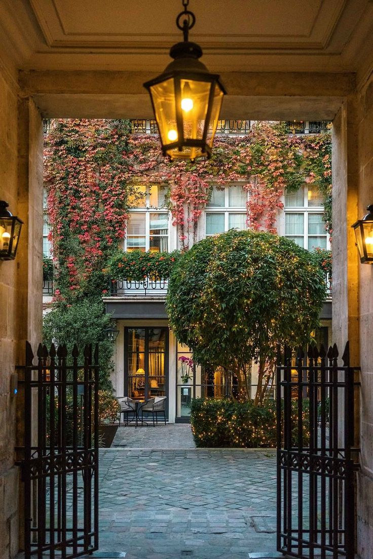 Access to Pavillon de la Reine isvia a private garden courtyard set back from Place des Vosges, making it feel like your own private hideaway