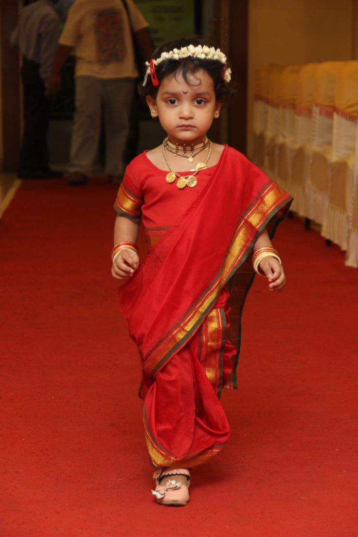 Baby girl in traditional maharashtrian nine yard saree