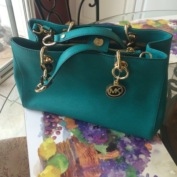 ✨Michael Kors Cynthia teal purse✨ Teal with gold and tortoise accents. Has plastic tag still on it but not price tag. Never worn Michael Kors Bags Shoulder Bags