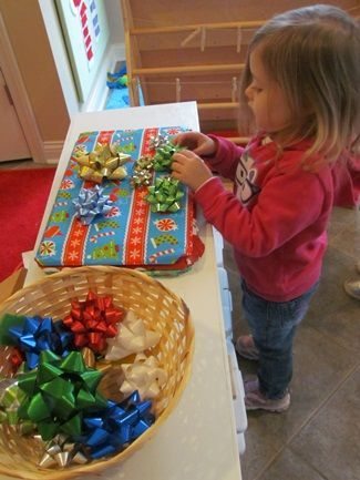 Magnetic bows and wrapped cookie sheets: Lots of language possibilities here- and the kids love it!