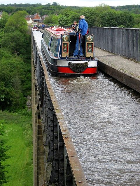 Narrowboat on Aqueduct Bridge in Britain. Don't look down!