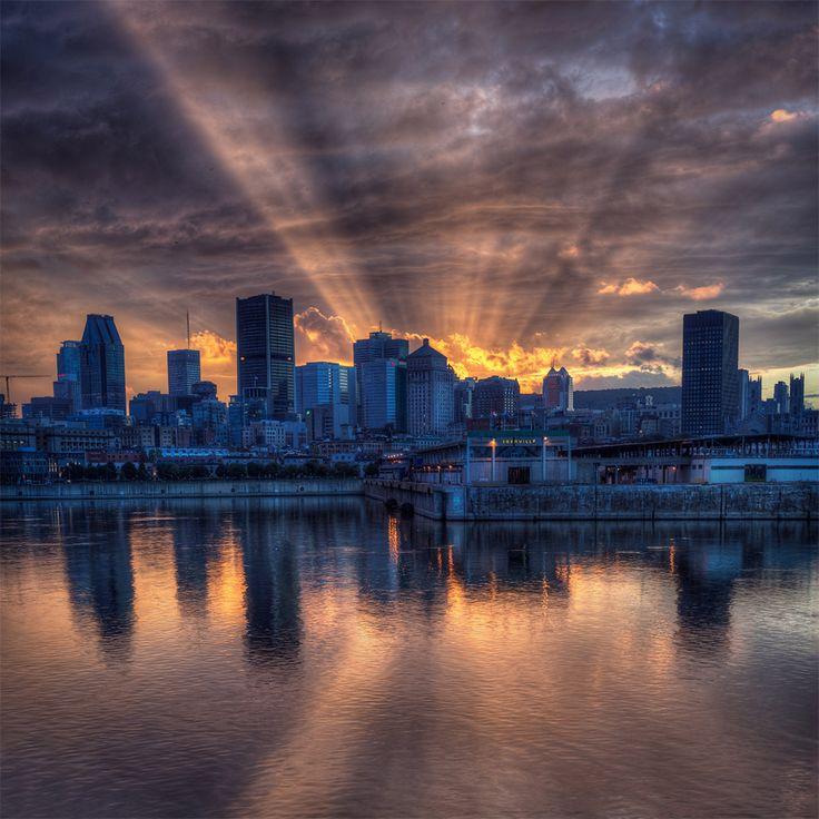 Sunshine Behind Montreal Skyline By Alex Rykov