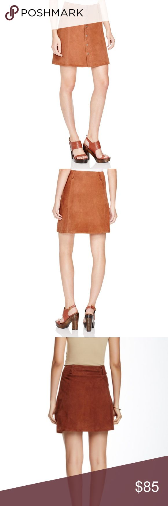 """Sanctuary Anita Suede A Line Skirt •Belt loops, A-line silhouette •Front snap closures, lined •Leather; lining: polyester •Professional leather clean Details:- Full length front snap button closure - Suede construction - Approx. 17"""" length - ImportedFiber Content:Shell: 100% leather Lining: 100% polyesterCare:Professional leather clean onlyAdditional Info:Fit: this style fits true to size.  Model's stats for sizing: - Waist: 23"""" Model is wearing size S. marks in suede due to nature of…"""