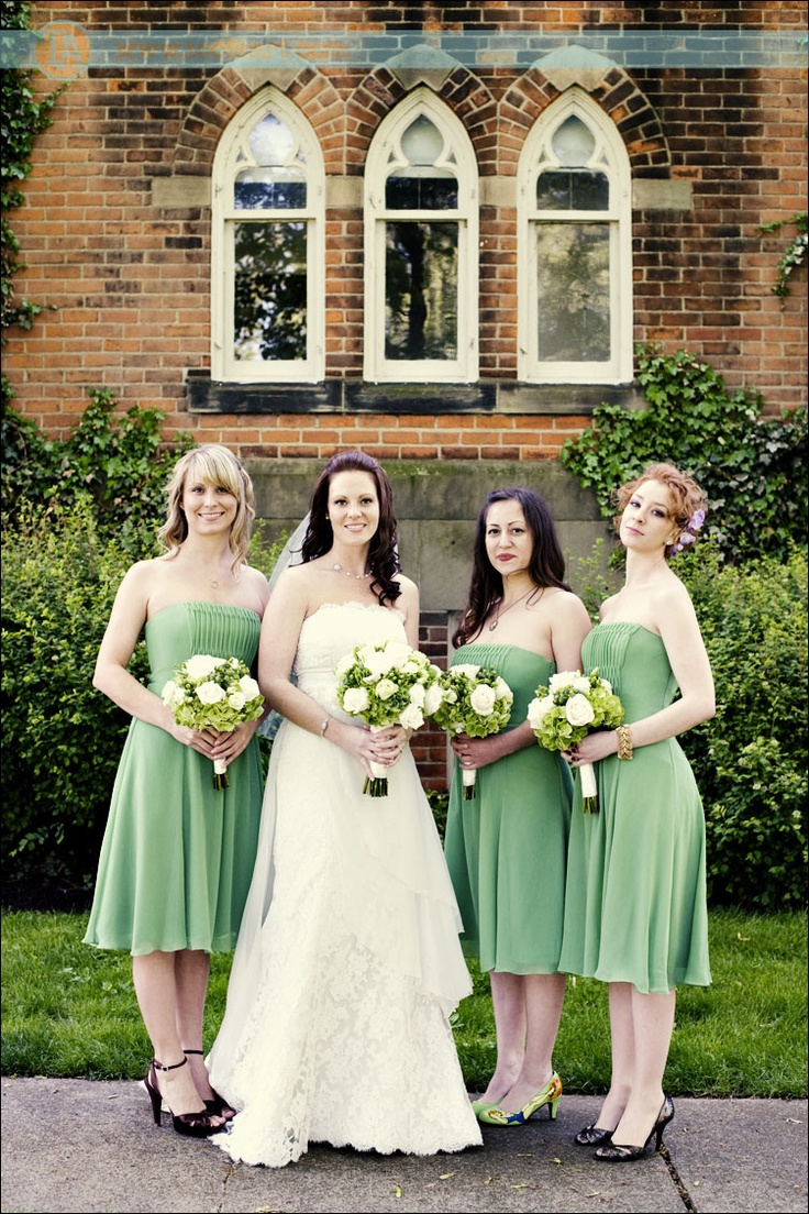 Cute green smocked bridesmaids dresses, would be great for a summer wedding or a pregnant maid.  Photo by Toole Art.