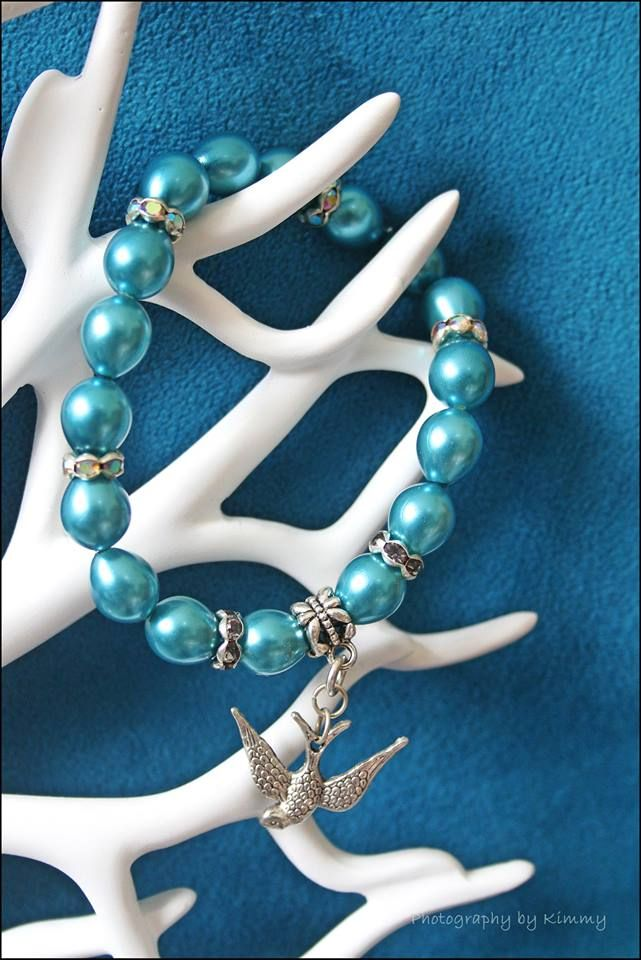 Blue painted glass pearls on stretchy elastic with crystal rondelles and silver dove pendant