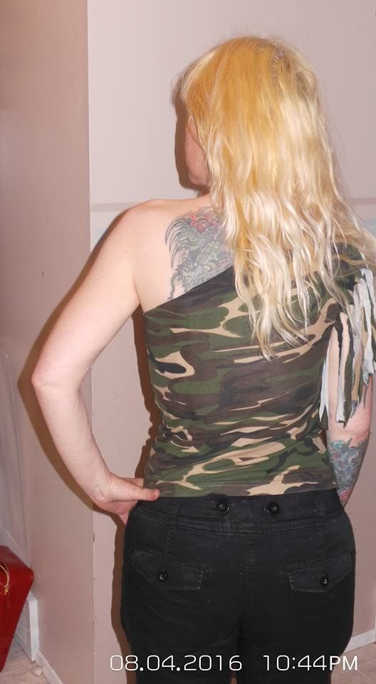 Mens size large camo tshirt that I cut up and sewed into a ladies small, off the shoulder, 1 arm fringe shirt.