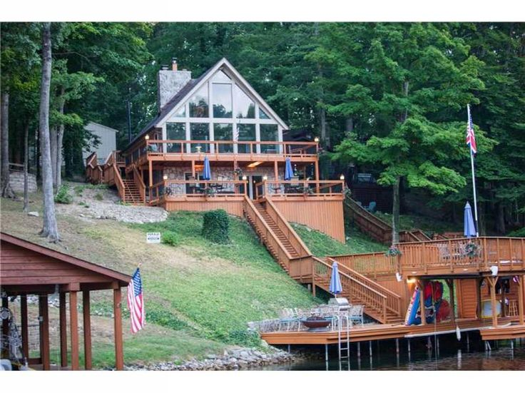 A-Frame lakefront home with wall of windows for spectacular views of Sweetwater Lake year round. Numerous improvements including new traditional furnace/AC and control panel, stone fascia installed to cinder block on exterior, various wood panels/fascia replaced/painted outside of home and Garage, updated electrical throughout, inside and out, new paint throughout. Galley updated Kitchen with new counters, new wall tiles, faucet. Great Room with wall of windows for spectacular lake views…