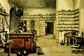 """Plate showing Faraday's laboratory, from The life and letters of Faraday, by Michael Faraday, 1791-1867, edited by Bence Jones, 1814-1873. London: Longmans, Green and Co., 1870. The title """"Faraday's Laboratory at the Royal Institution"""" is given beneath the engraving."""