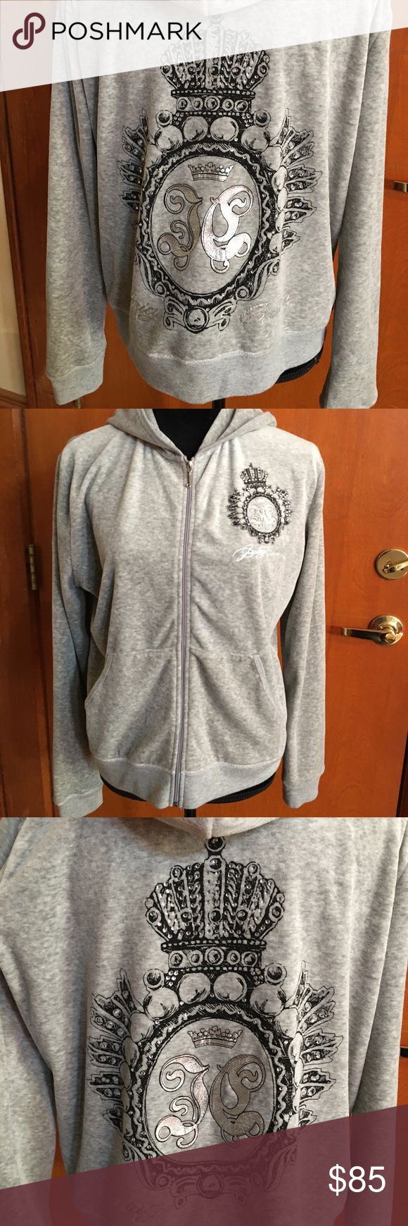 Juicy Couture Gray Velour Hoodie w/ Crystals NWOT This is a brand-new juicy couture gray velour hoodie with crystal accents. Has a beautiful sparkle. This is a boutique piece purchased about 10 years ago from the juicy couture boutique in New York City. You won't find this sexy hoodie anywhere else! Ladies size extra-large. No trades please. Juicy Couture Tops Sweatshirts & Hoodies