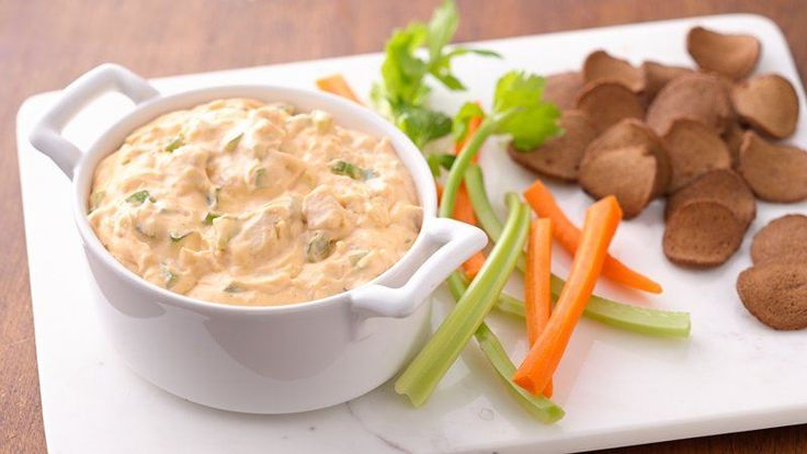 Love the flavors of Buffalo chicken? This creamy, easy, five-ingredient Buffalo chicken dip packs all of the flavors of Buffalo wings without the mess. Made with precooked chicken, blue cheese dressing, Buffalo sauce, cream cheese and chopped celery, it's a crowd-pleasing dip with a serious kick.