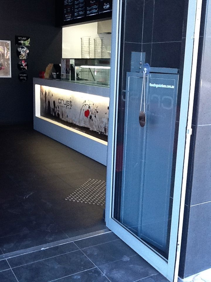 Innovative discreet bi-fold flood doors fold back behind normal shopfront door set at & 9 best Flood Barriers images on Pinterest | Flood barrier Mall ...