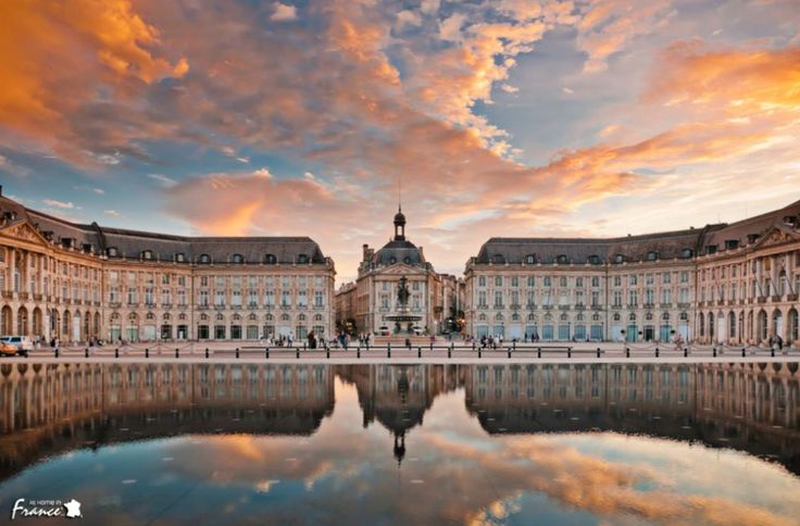 "The ""Place de la Bourse""  This incredible square was built between 1730 and 1775 by the King's architect and is home to the world's biggest water mirror (37135 sq ft).   Doesn't this just make for the perfect photo opportunity?"