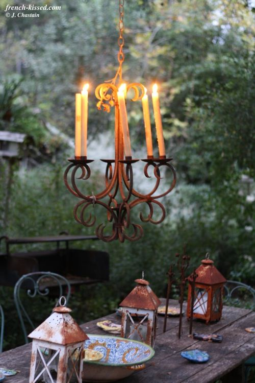 Love the chandelier and the rustic lanterns