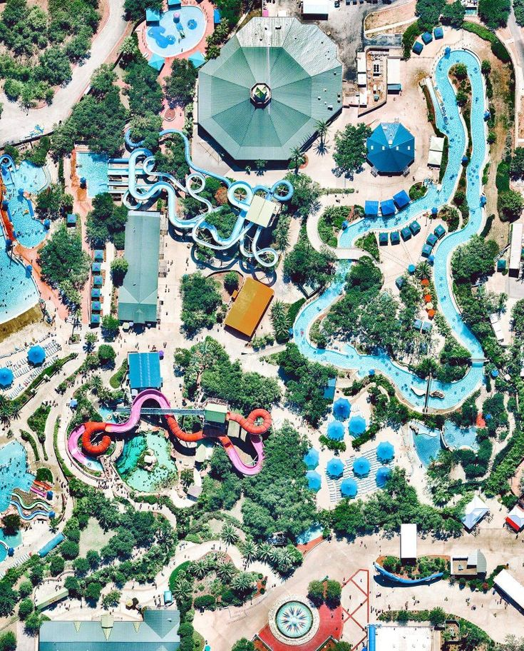 """Check out this Overview of Aquatica, a water park in San Antonio, Texas. Constructed in 2012, Aquatica boasts several water slides, pools, a 42,000-square-foot beach area, an aviary, and its signature """"Stingray Falls,"""" a family raft ride that runs through an underground grotto full of stingrays and tropical fish.  Instagram: https://bit.ly/2EYfdtR  29°27'30.3""""N, 98°41'53.3""""W  Source imagery: Nearmap"""