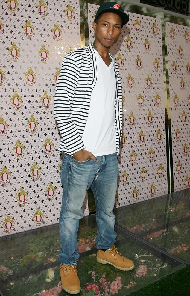 """Pharrell Williams attends the launch party for his new liqueur """"Qream"""" on July 14, 2011 in Hollywood, California."""