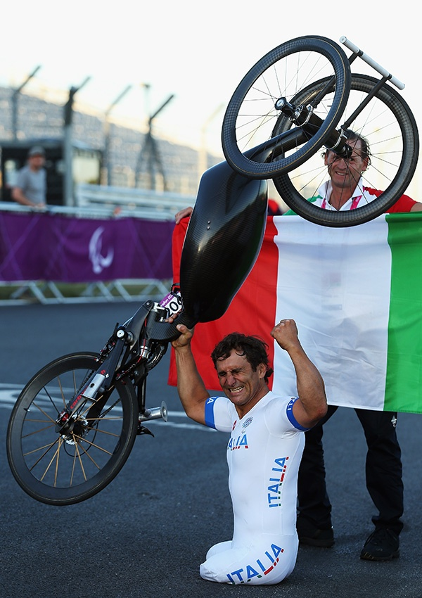 Alessandro Zanardi of Italy celebrates winning the Men's Individual H4 Road Race on day 9 of the London 2012 Paralympic Games at Brands Hatch on September 7, 2012 in Longfield, England. (Photo by Bryn Lennon/Getty Images)