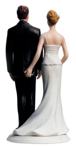 "Life is all about the little moments. Particularly those that no one knows about but you. This elegant couple takes romance - and fireworks - to a new level. Poised and elegant from the front, the back reveals a hidden little pinch - and a few extra ""sparks"". Hand painted porcelain. Available in Caucasian and Ethnic. Presently the Bride and Groom Cake Toppers are available with skin tones and hair colors only as shown."